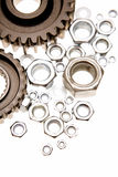 Cogs and nuts. On white Royalty Free Stock Photos