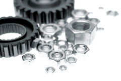 Cogs and nuts. On white Royalty Free Stock Image