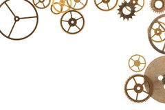 Cogs Isolated. Cogs and other watch parts isolated on white background with copy space Royalty Free Stock Images