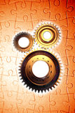 Cogs and puzzle. Three gears and jigsaw puzzle Stock Image