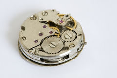 Cogs on watch. Cogs on time-piece reverse Royalty Free Stock Photos