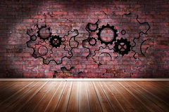 Cogs and wheels on brick wall Stock Photo