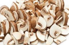 Cogumelos cortados no branco Fotografia de Stock Royalty Free