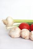 Cogumelos e tomates. Imagem de Stock