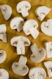 Cogumelos em um fundo de madeira Imagens de Stock