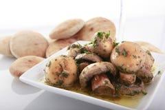 Cogumelos no molho de alho Foto de Stock