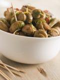 Cogumelos pstos de conserva pimentões de Ajillo- do al de Championes Foto de Stock