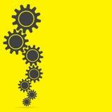 Cogwheel, желтая предпосылка Стоковое Изображение