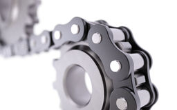 Cogwheel with chain Stock Photos