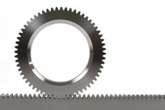Cogwheel and cograil. Front view of an connection of a  cogwheel and a cograil isolated on white background Stock Image