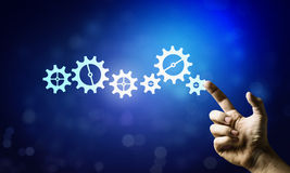 Cogwheel mechanism as teamwork concept Royalty Free Stock Image