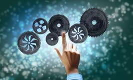 Cogwheel mechanism as teamwork concept Stock Image