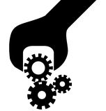 Cogwheel in screwdriver  Royalty Free Stock Image