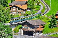 Cogwheel train from Kleine Scheidegg. Stock Photo
