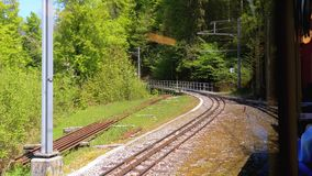 Cogwheel Train in Mountains. Train in Steep Mountains Driving Uphill. Switzerland, Montreux, Rochers-de-Naye. Cogwheel Train in Mountains. Train in Steep stock video