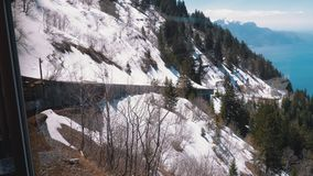 Cogwheel Train in Snowy Mountains. Train in Steep Mountains Driving Uphill. Switzerland, Alps. Cogwheel Train in Snowy Mountains. Train in Steep Mountains stock footage
