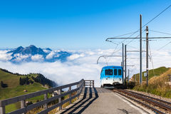 Cogwheel train on top of Rigi mountain. The cogwheel train for tourists running toward the top of Rigi mountain. Famous tourists place near Lucerne, Switzerland royalty free stock photography