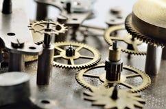 Cogwheels в старых часах Стоковое Фото
