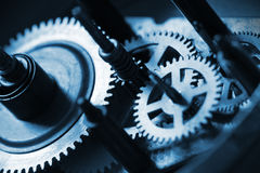 Cogwheels. Detail of cogwhells in old clock Stock Image