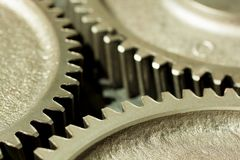 Cogwheels of a diesel power station. Industrial cogwheels in close up Stock Photo