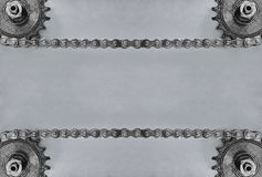 Cogwheels and double chain on grey background with empty space. Stock Images