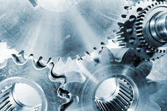Cogwheels and gears in steel toning Stock Photos