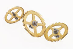 cogwheels guld- gammala tre Royaltyfria Bilder