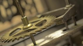 Cogwheels inside an old pendulum clock. stock video footage