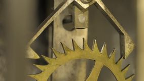Cogwheels inside an old pendulum clock. stock footage