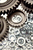 Cogwheels and nuts. A closeup of cogwheels and nuts in varying sizes Stock Image