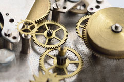 Cogwheels in old clock Royalty Free Stock Images