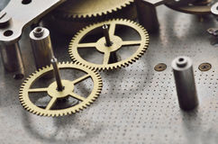 Cogwheels in old clock Royalty Free Stock Image
