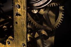 Cogwheels in old clock Stock Images