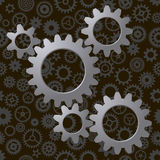 Cogwheels on seamless pattern with lots of cogwheels (gears) Royalty Free Stock Photo