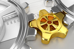 Cogwheels and Sheet. Cogwheels (Chrome/Gold) and Sheet - On Gray Background Royalty Free Stock Photography