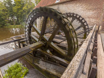 Cogwheels at a watermill. Working Cogwheel driven watermill at Singraven castle in Dinkelland, Netherlands Stock Photography