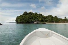 Coiba. Boat approaching Coiba Island - Panama Royalty Free Stock Images