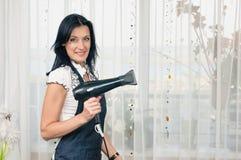 Coiffeuse de femme Photographie stock libre de droits