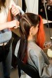 Pettinatura della donna. fotografie stock