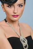 Coiffure quiff. Portrait of beautiful girl with elegant coiffure quiff in black dress Royalty Free Stock Images