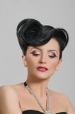 Coiffure quiff. Portrait of beautiful girl with elegant coiffure quiff in black dress Stock Images