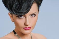Coiffure quiff. Portrait of beautiful girl with elegant coiffure quiff in black dress Royalty Free Stock Photo