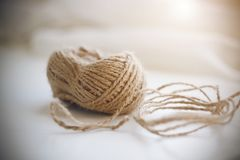A coil of beige coarse hemp rope stock photo