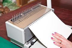 Coil Binding Machine Stock Photo