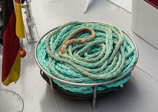 Coil of blue nylon rope on deck Royalty Free Stock Photos