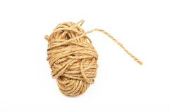 Coil bobbin of burlap jute rope over white Royalty Free Stock Photo