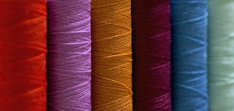 Coil with colored threads Stock Image