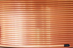 Coil of copper pipe. For installation of pipelines for water and other liquids stock photo