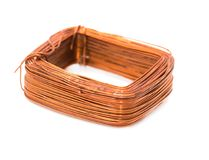A coil of copper wire on a white background Royalty Free Stock Photo