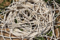 Coil of electrical wire lying on the ground Royalty Free Stock Photography